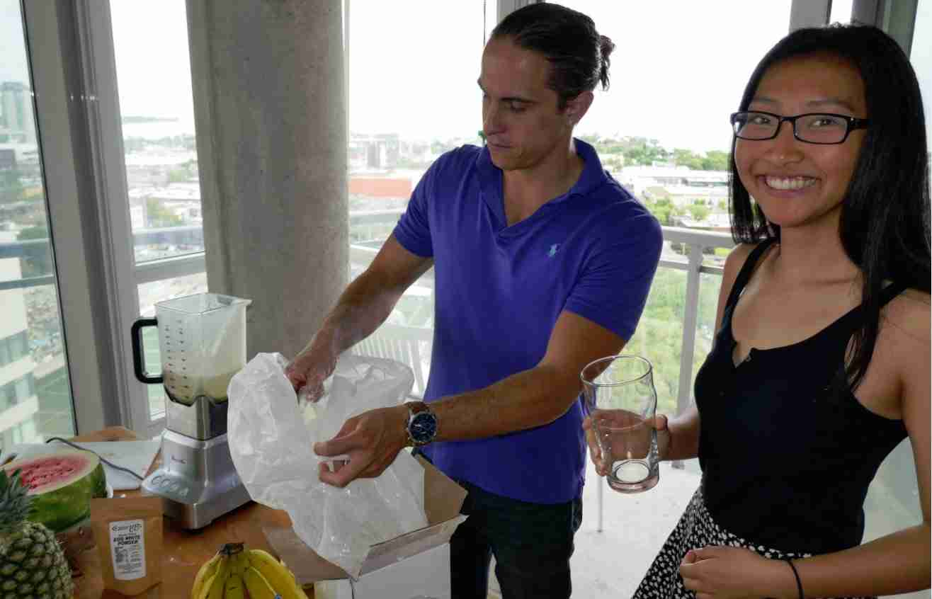 Martin makes fruit smoothies in Parkdale condo